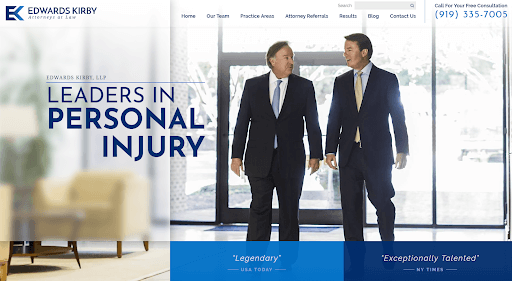 "Homepage of the website for Edwards Kirby, LLP showing two male attorneys walking side-by-side, with the message, ""Leaders in Personal Injury""."