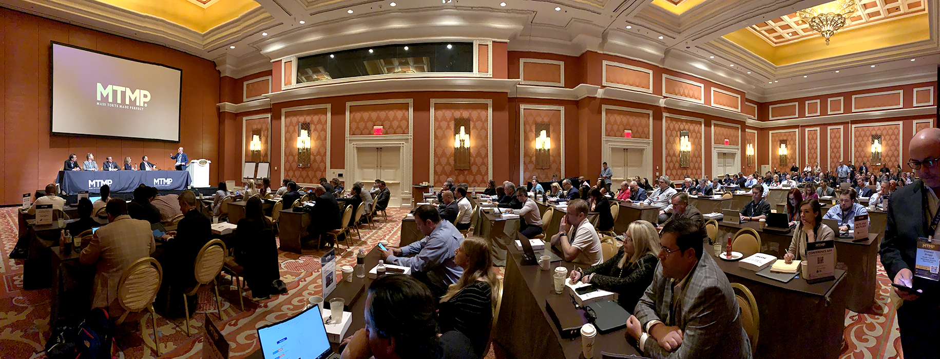 Panoramic view of a large crowd attorneys sitting in banquet room