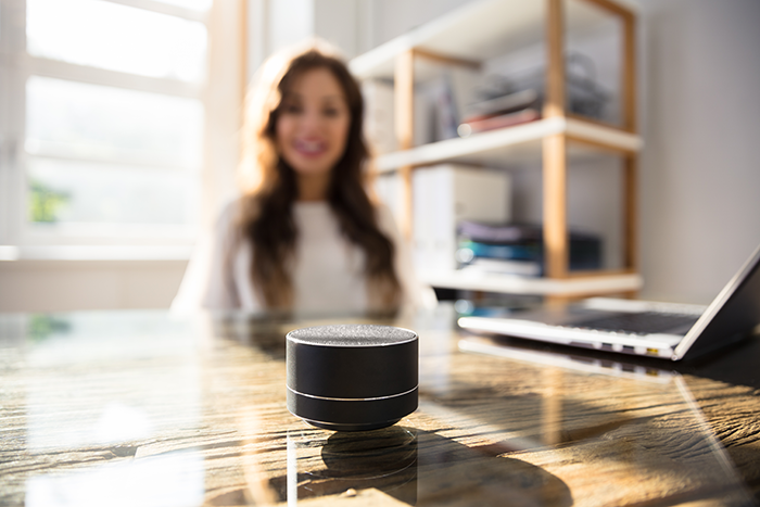 woman using Amazon echo