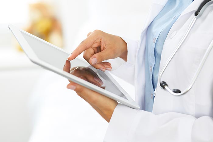 image of doctor looking at tablet