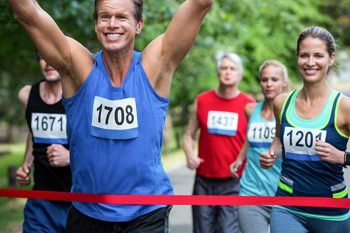 image of runner running across finish line
