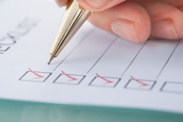 checklist being marked off on paper